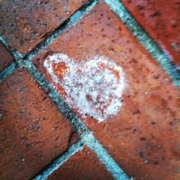 a #Signoflove in a broken down brick