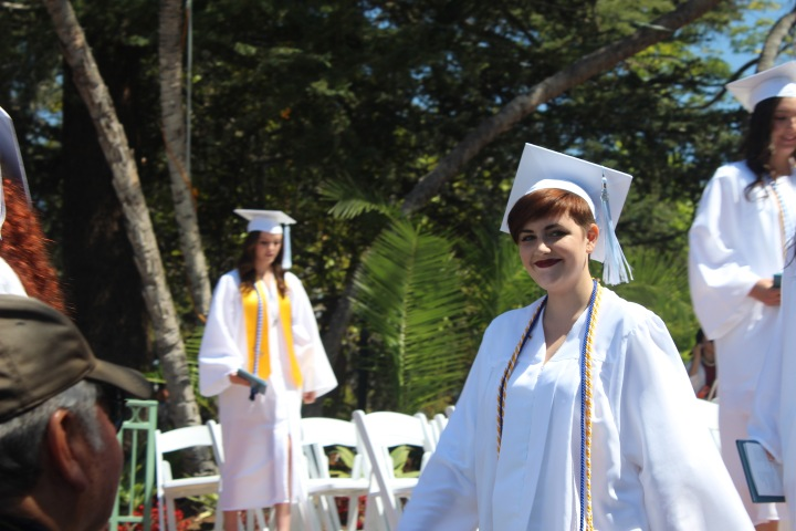 Keara walks down the aisle after graduation.